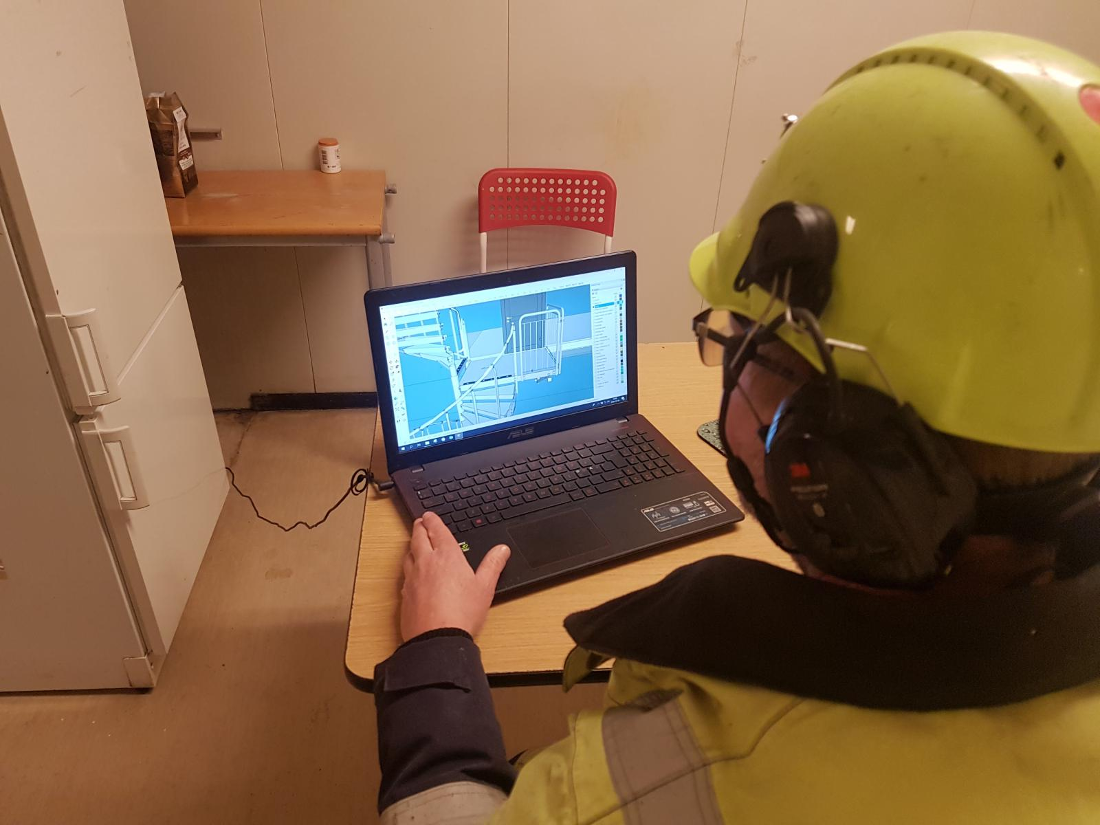A construction team member navigates through a SketchUp model