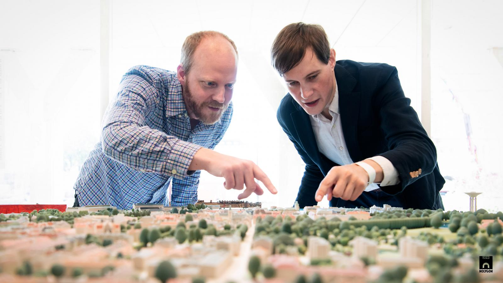 Felix and Anders inspect their 3D-printed model of the Swedish city of Landskrona during the unveiling ceremony.